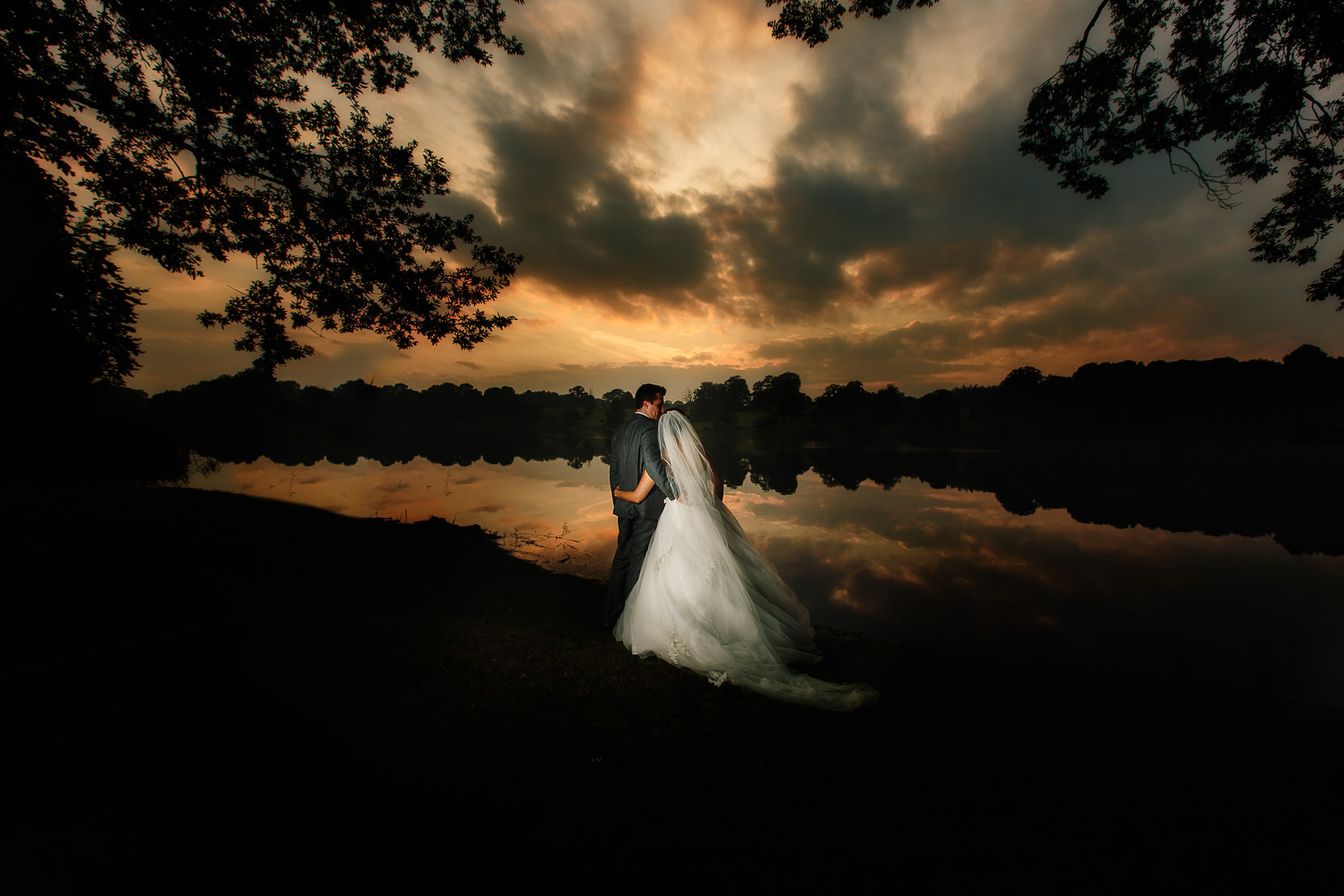 Shropshire Wedding Photography with a bride and groom in a stunning sunset at Combermere Abbey