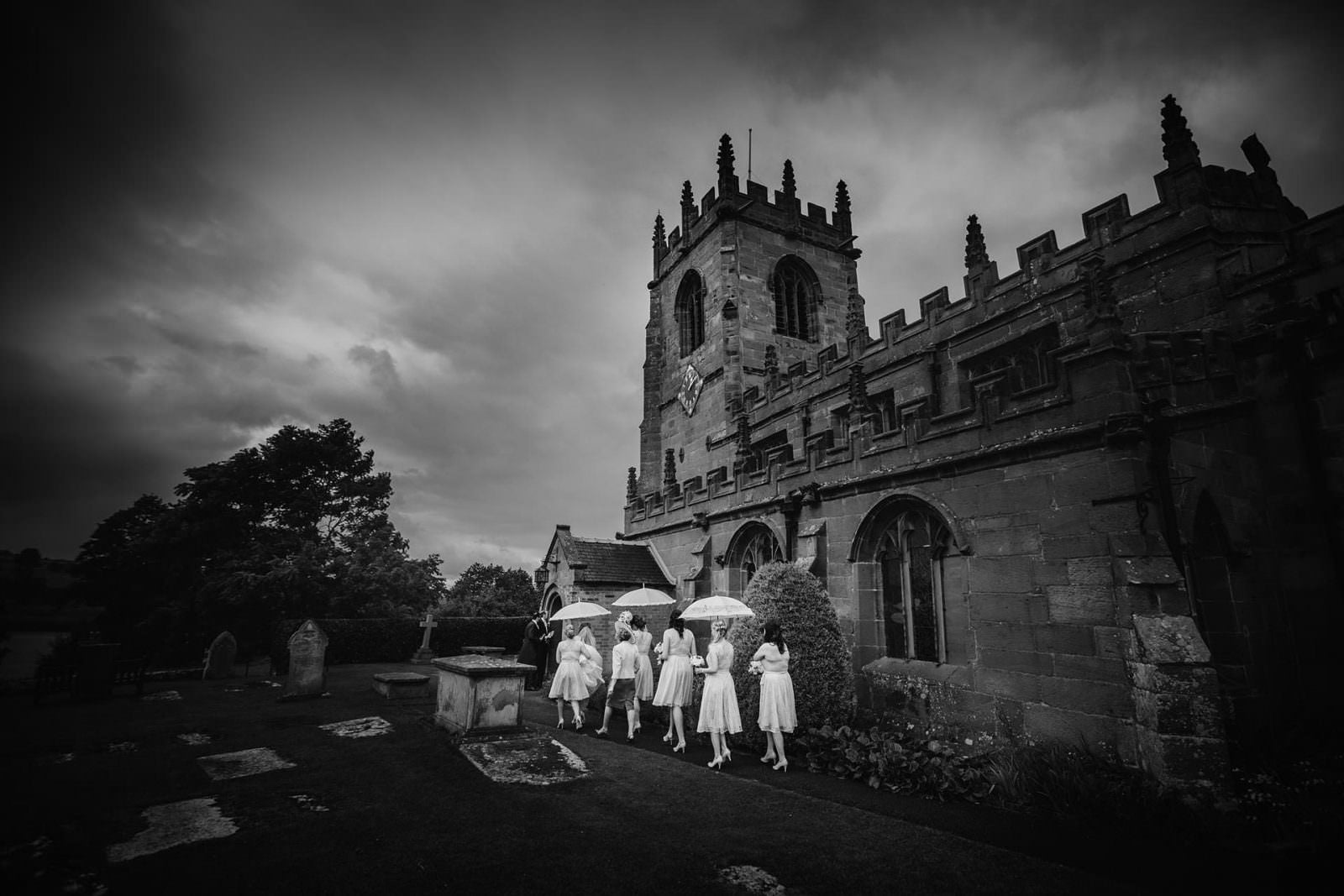 Shropshire Documentary Wedding Photographer with bridal party at Church