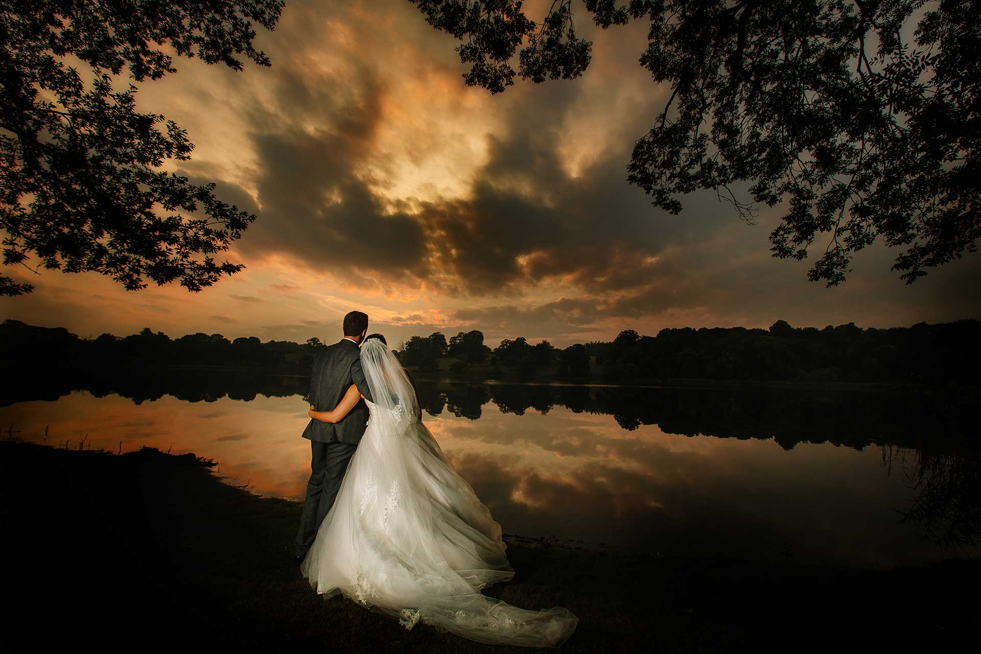 A stunning sunset with a bride and groom at Combermere Abbey by Qualified Shropshire Wedding Photographer pbartworks