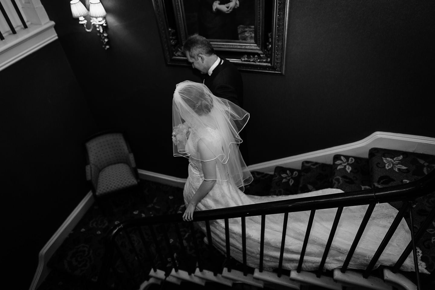 Rowton Castle Wedding Photographer pbartworks captures Rachel and her Father descending the staircase