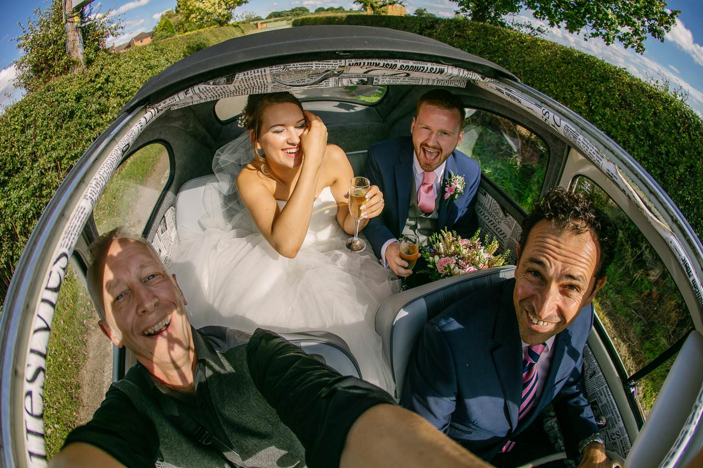 shropshire wedding photographer phil barrett with bride and groom aboard Herbie