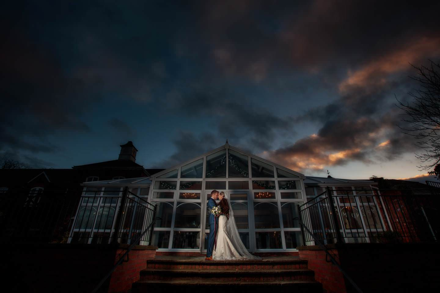Aimee and Mike enjoy their creative Lion Quays Wedding Photography outside the reception venue with PbArtWorks