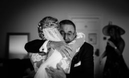 Bride and her Father embrace as Shropshire wedding photographer captures the moment
