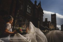 the bride makes her way to the Church, in Whitchurch, Shropshire.