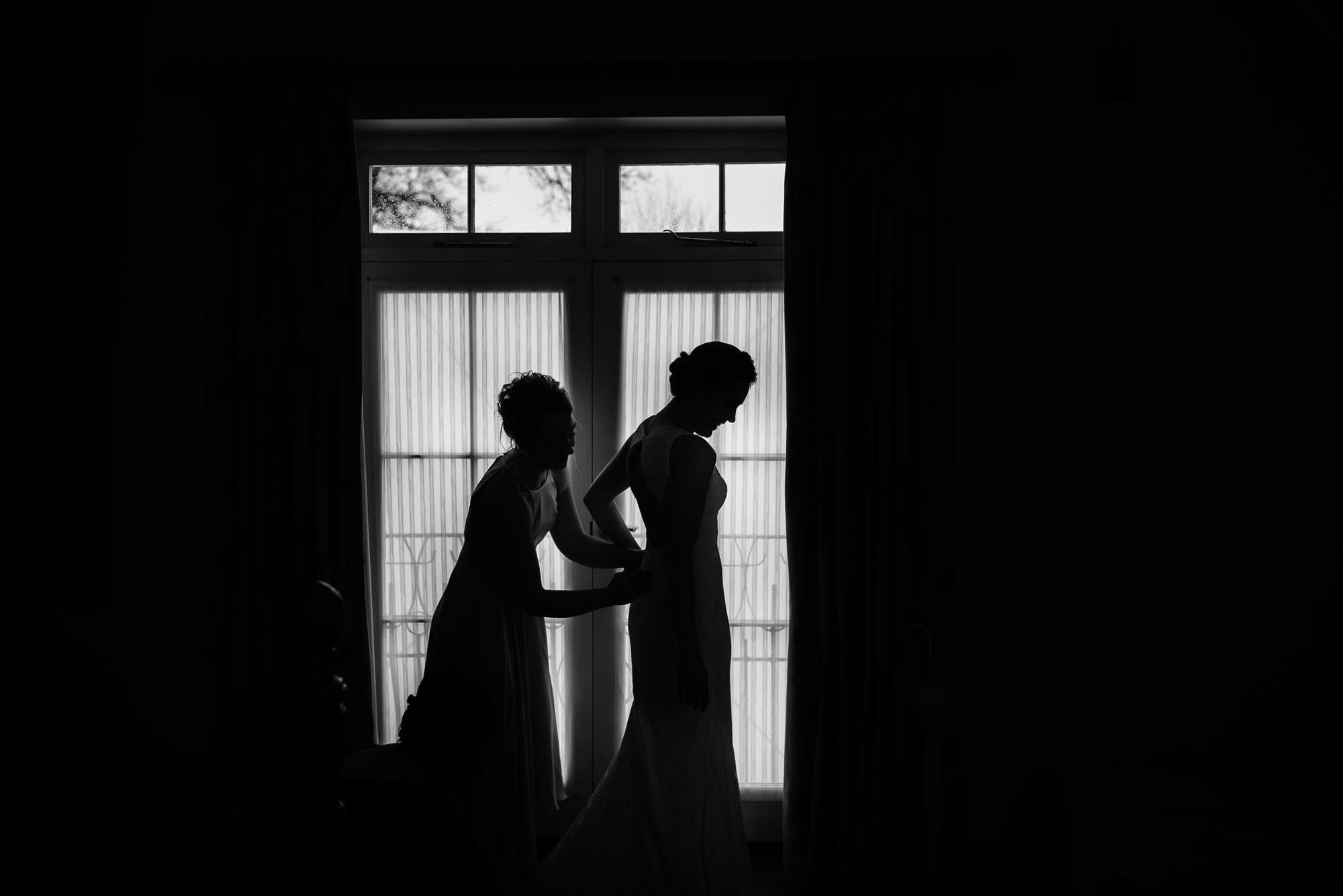 wedding photographer in shropshire captures a bride and her sister getting ready