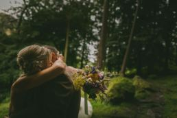 Wedding Photographer in Shropshire with bride and groom in woodland
