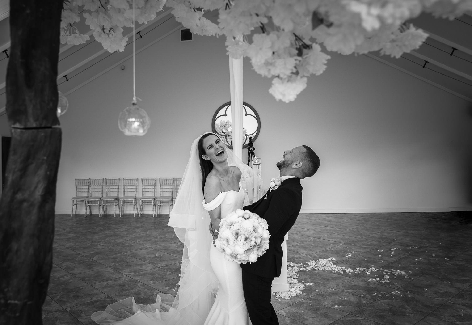 bride and groom enjoy a moment of fun at combermere abbey in Cheshire