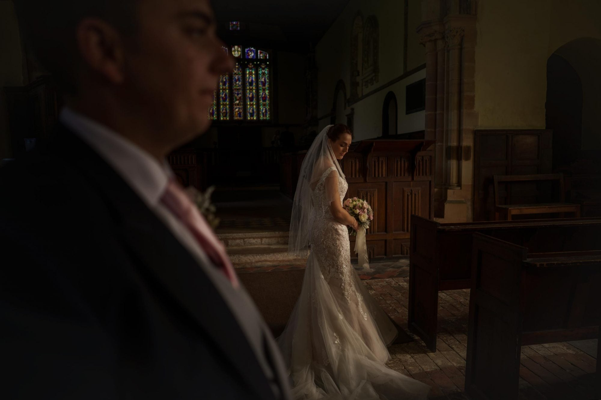 bride and groom at Wroxeter Church in Shropshire