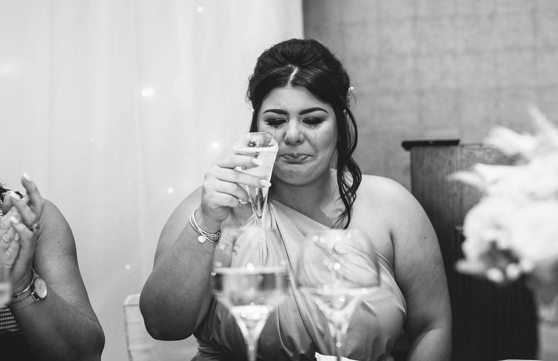 An emotional bridesmaid captured by Shropshire Documentary Wedding Photographer