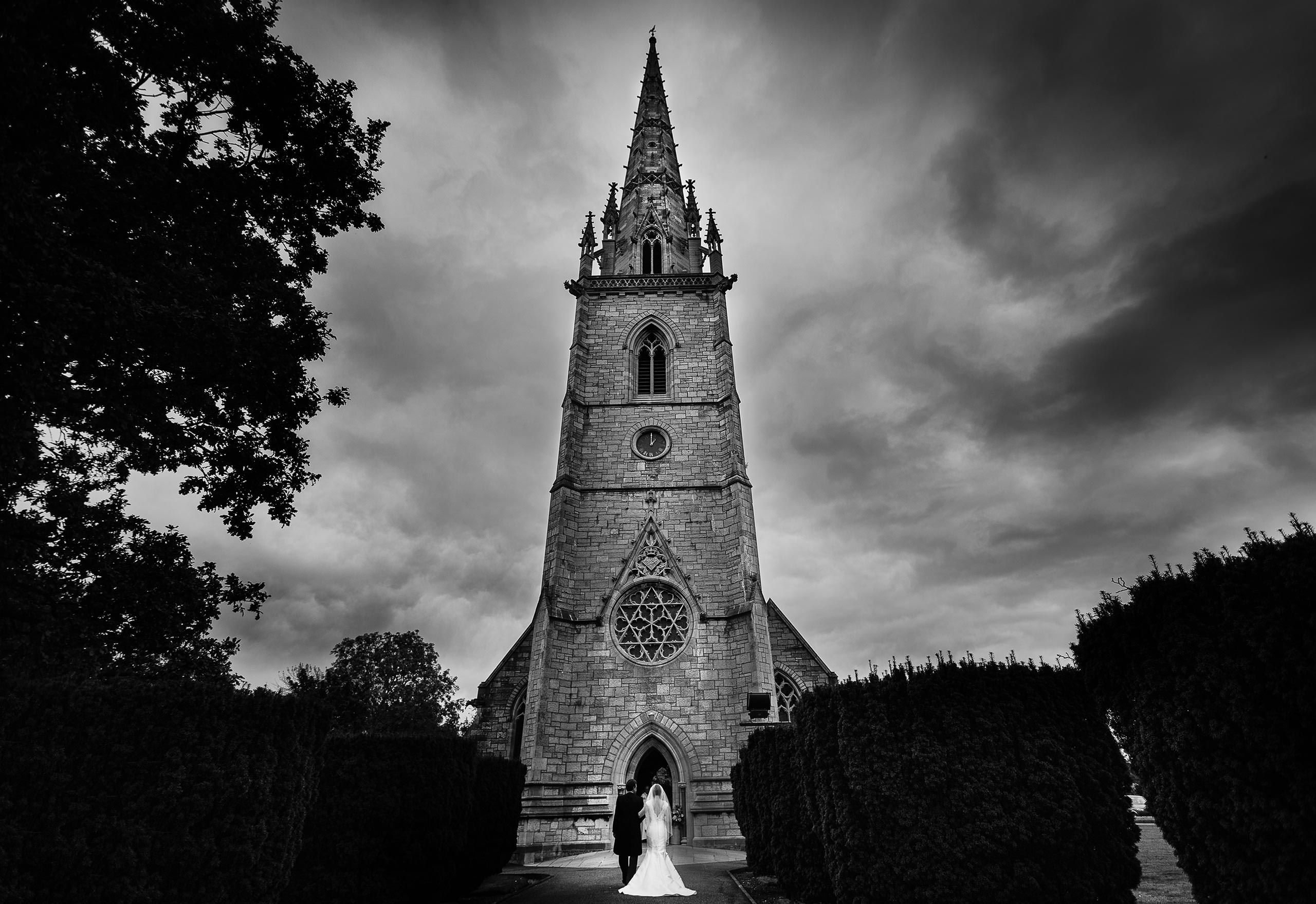 the bride and her Father arrive at the amazing Marble Church in North Wales captured by Shropshire documentary wedding photographer Phil Barrett