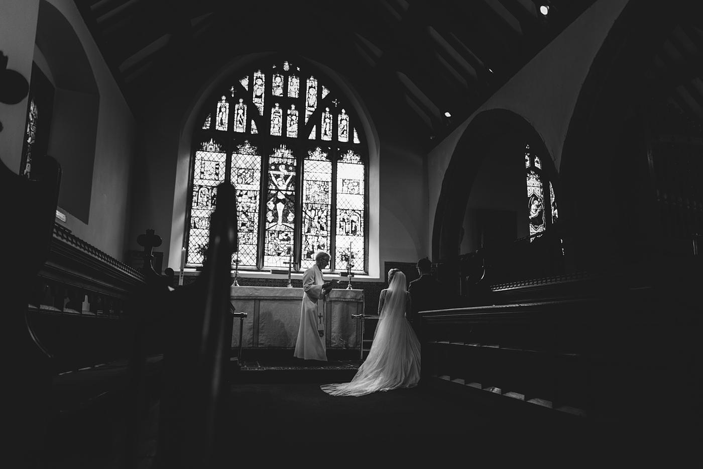 bride and groom led into prayer taken by North Wales Wedding Photographer Phil Barrett