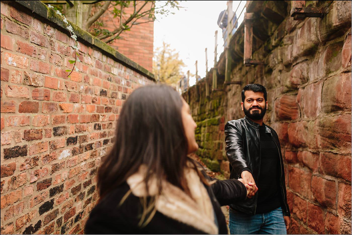 two guys walking through Chester with a wedding photographer in cheshire