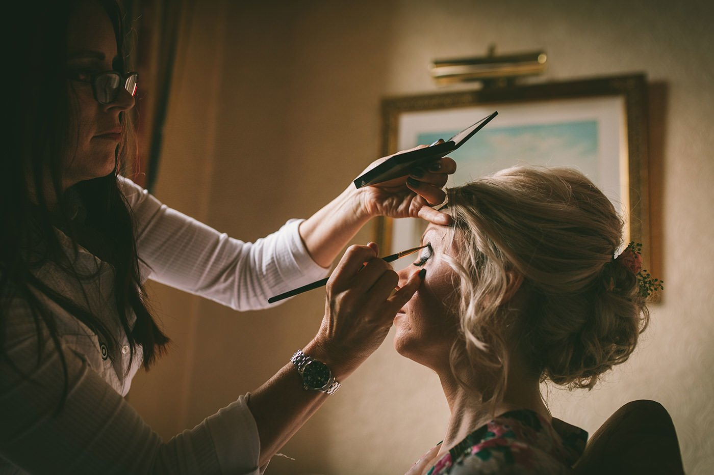 Shropshire Wedding Makeup Artist Applies make up to bride