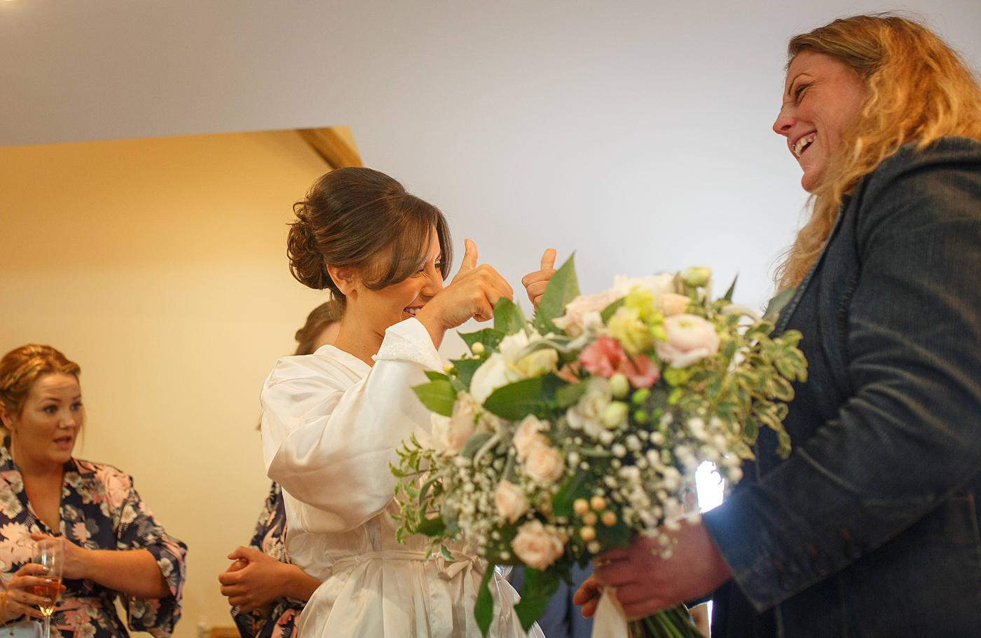 a bride inspects her bridal flowers