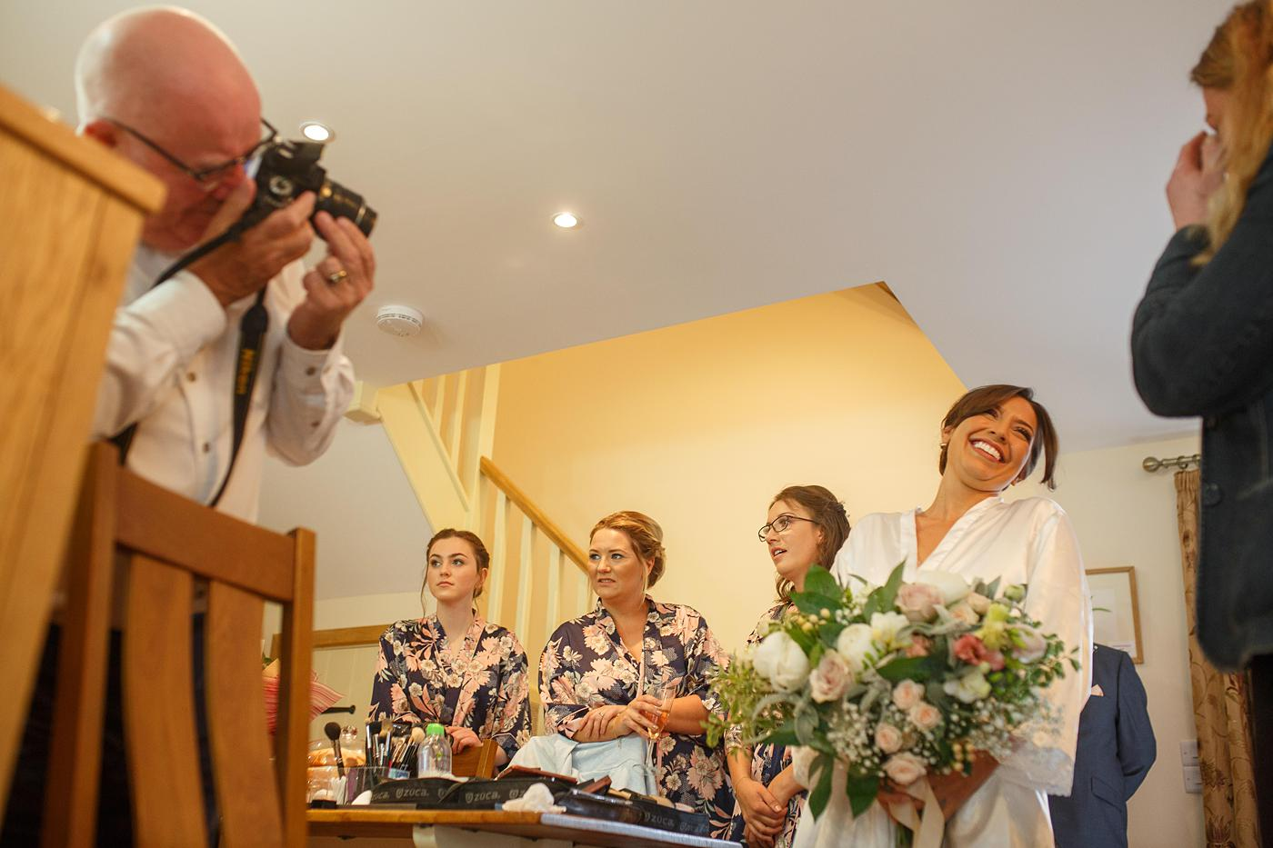 bride and bridesmaids having a photograph taken