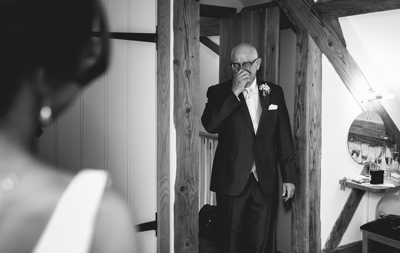 the father of the bride enters the room