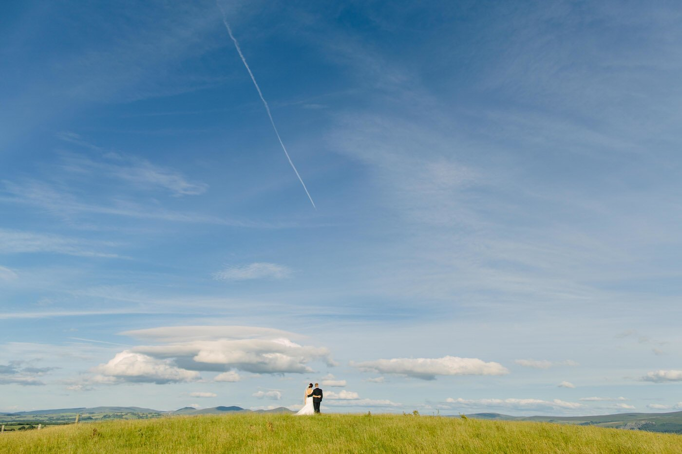 Bride and Groom on a welsh hillside at a North Wales Wedding