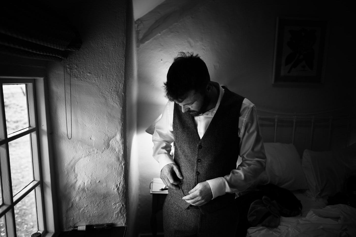 Groom getting ready at a Tyn Dwr Hall Wedding