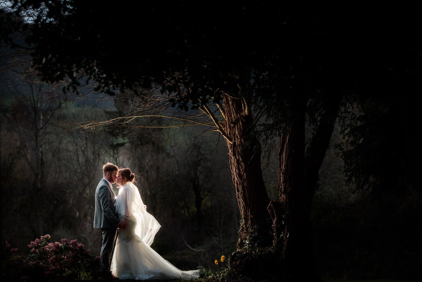 at a Tyn Dwr Hall Wedding a bride and groom share a tender moment