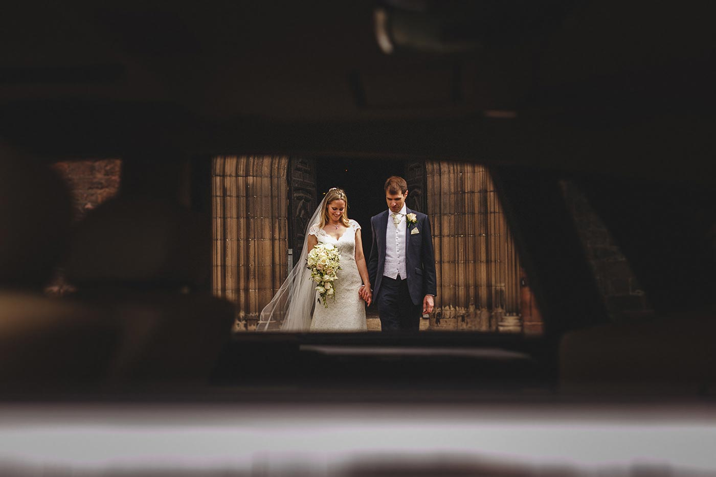 Bride and groom leaving Shrewsbury Abbey