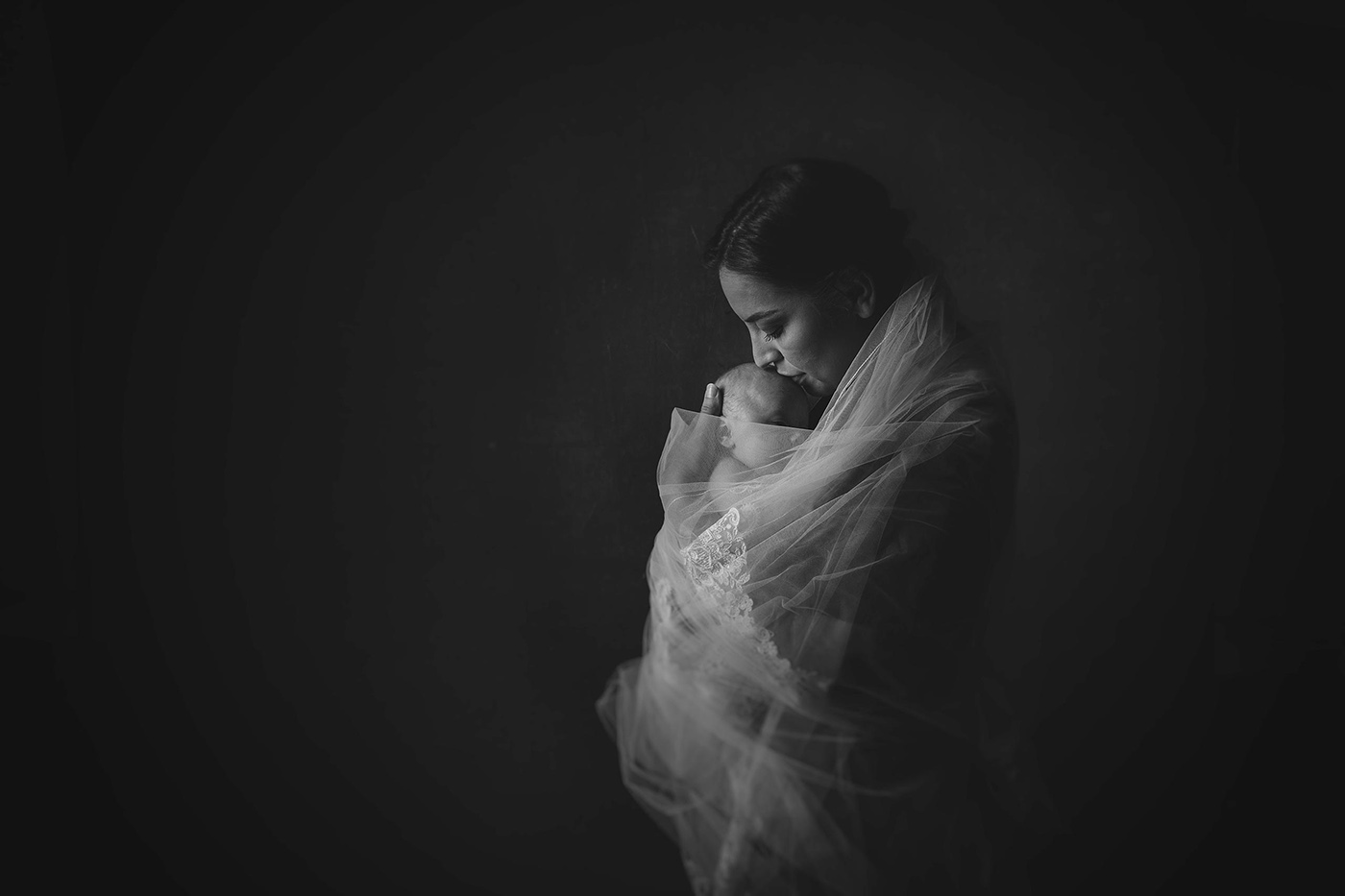 an artistic balck and white portrait of mother and newborn baby