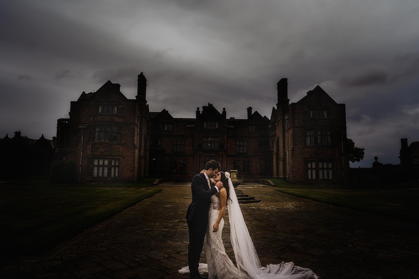 a stunning scene as a bride and groom are captured at Thornton Manor