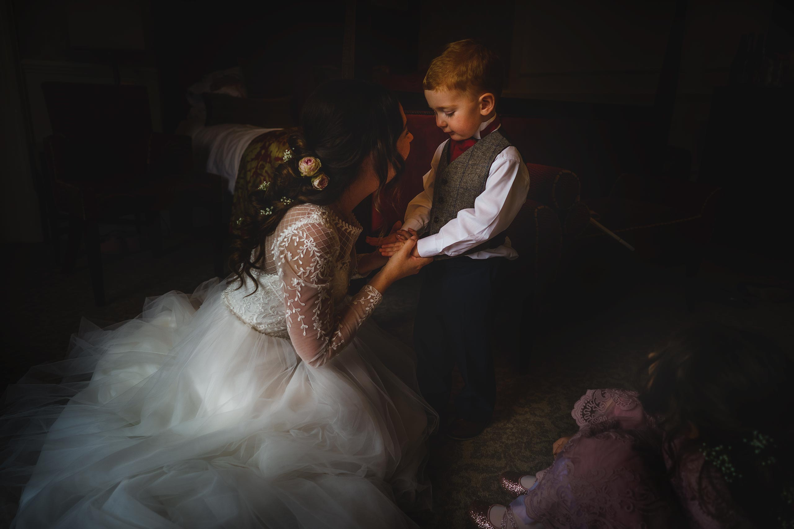 a tender moment between mother and son as she prepares to be married at Albrighton Hall in shropshire