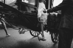 a bride steps out of her carriage in Shropshire