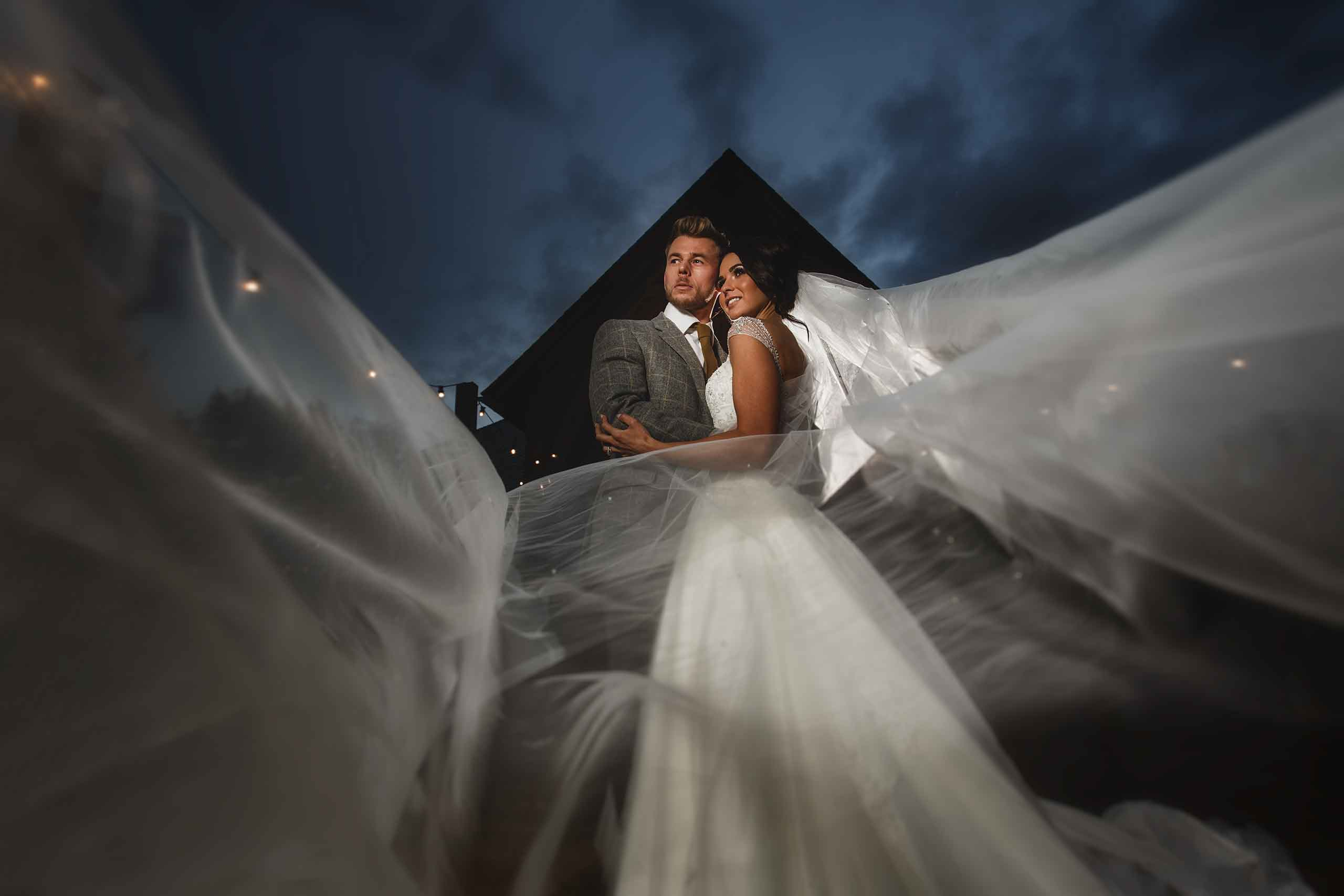 A bride and groom at the amazing Mill Barns Wedding Venue