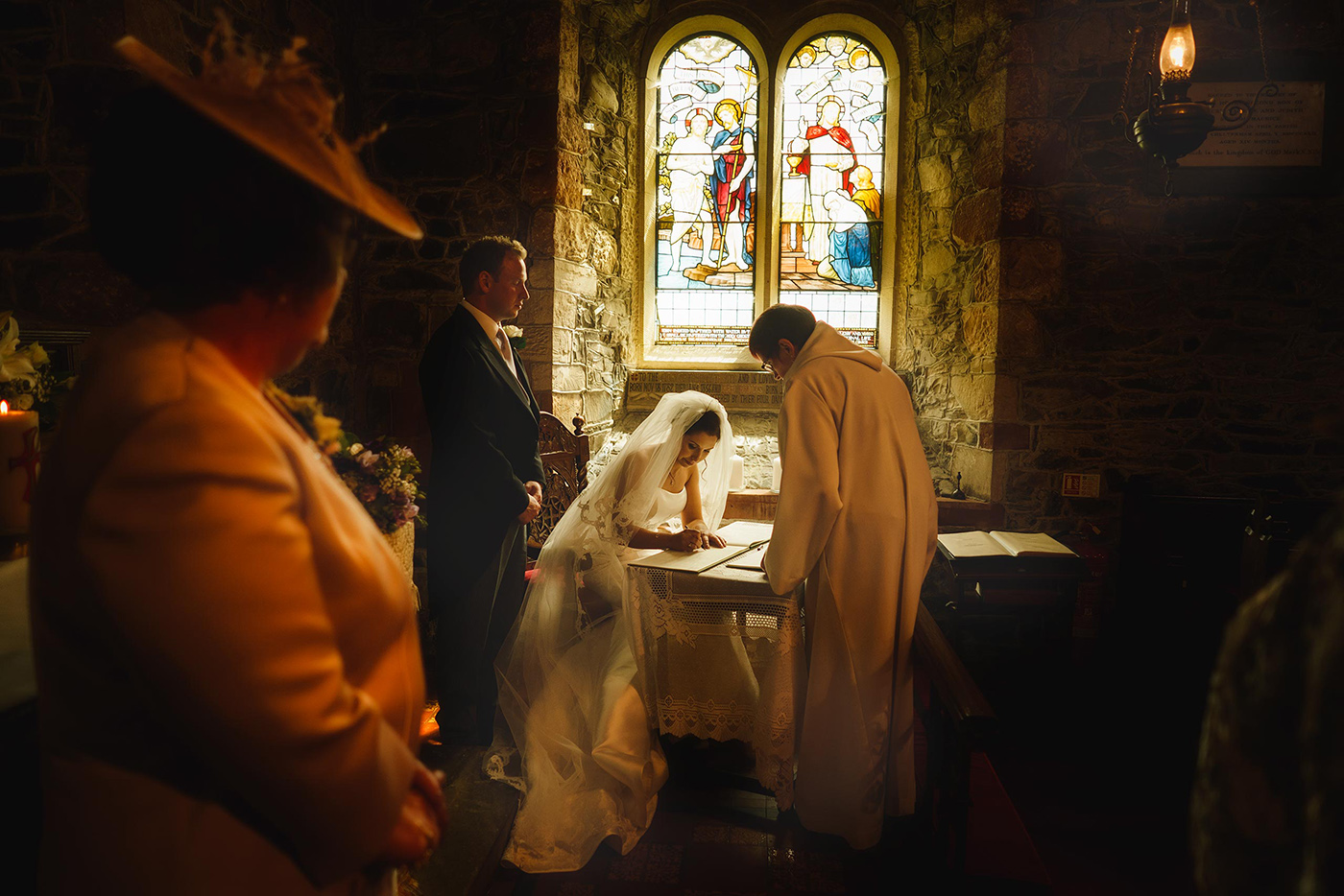 a bride signs the marriage register in a Shropshire church