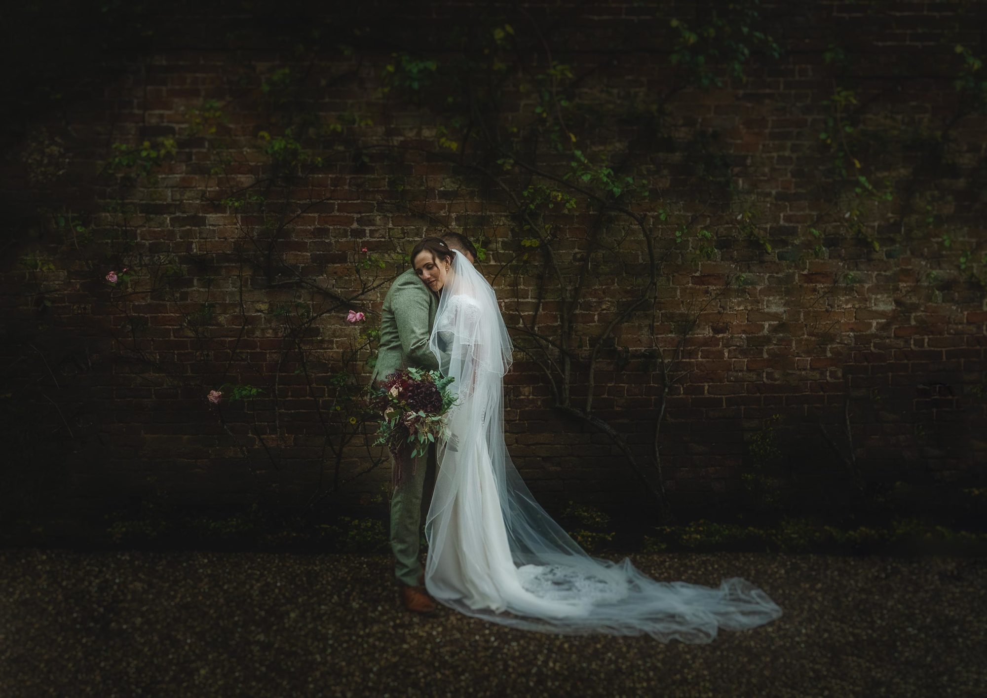 portrait of bride and groom at Iscoyd Park showing the brides beautiful dress and bouquet