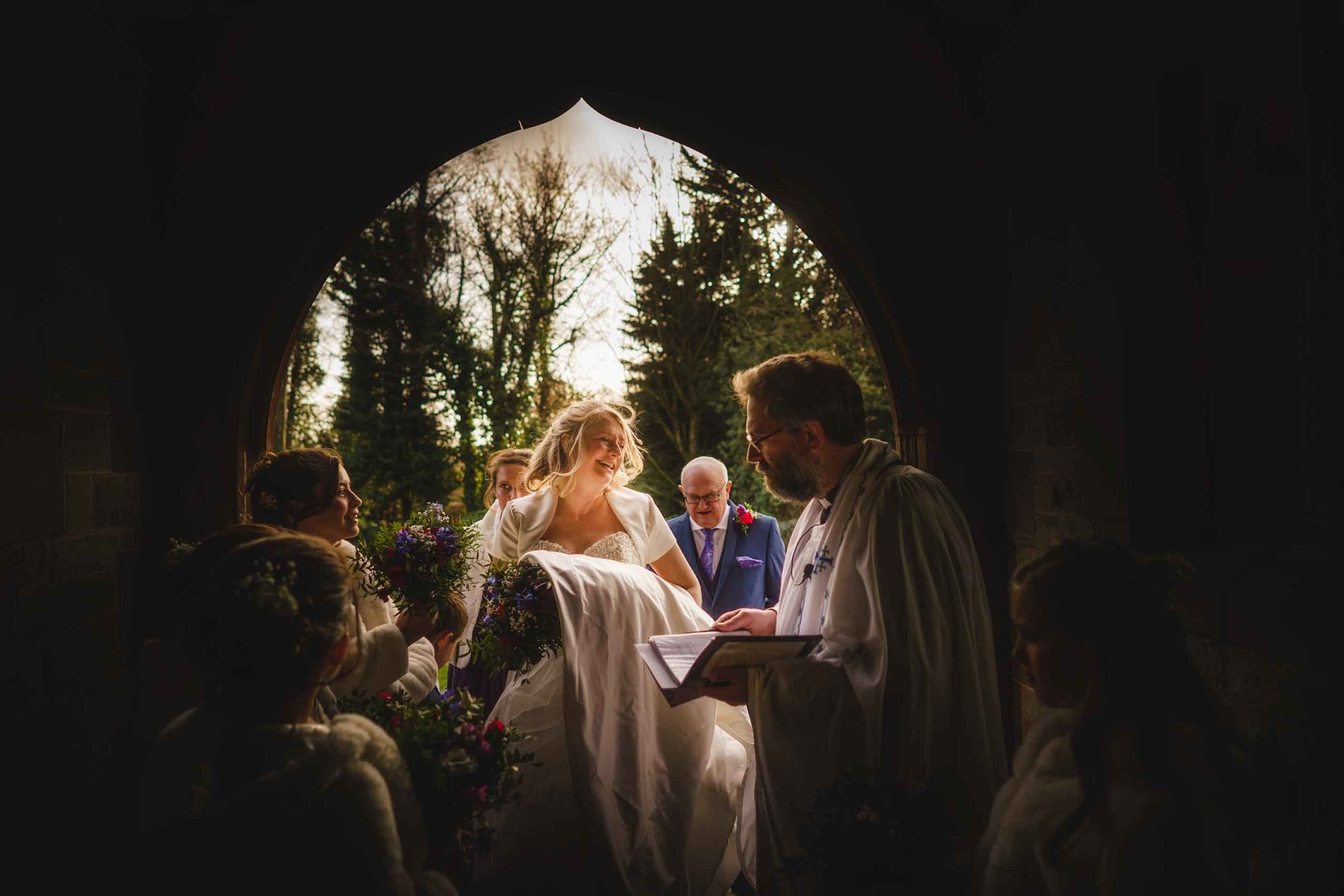 shropshire wedding and portrait photographer captures bride entering church
