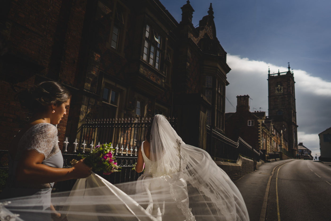 wedding photographer in shropshire captures bride and sister on the way to the church
