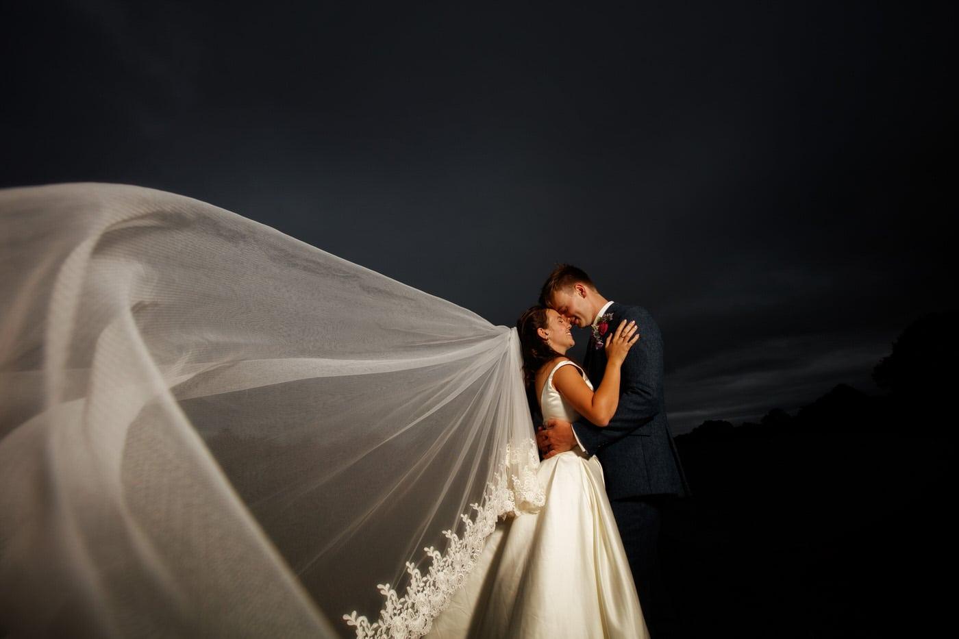 wedding photographer shropshire captures creative portrait of bride and groom