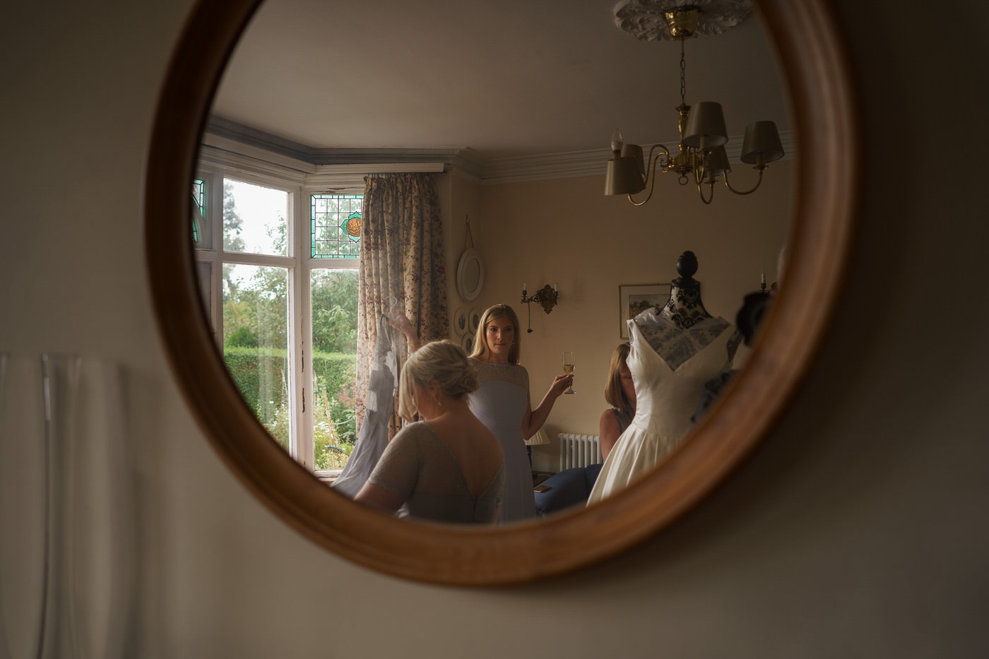 wedding photographer in shropshire captures candid moments at wedding in mirror