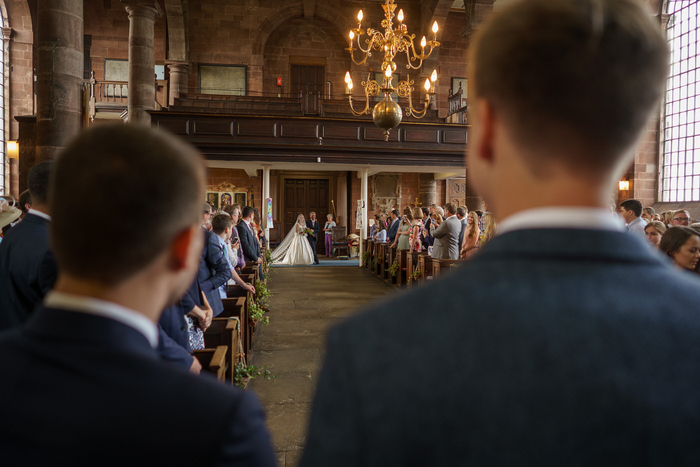 bride walks into the church with her father, in shropshire