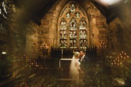 bride and groom take time out in a shrewsbury church