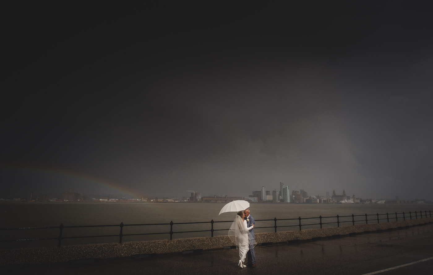 Bride and groom facing the storm in Liverpool