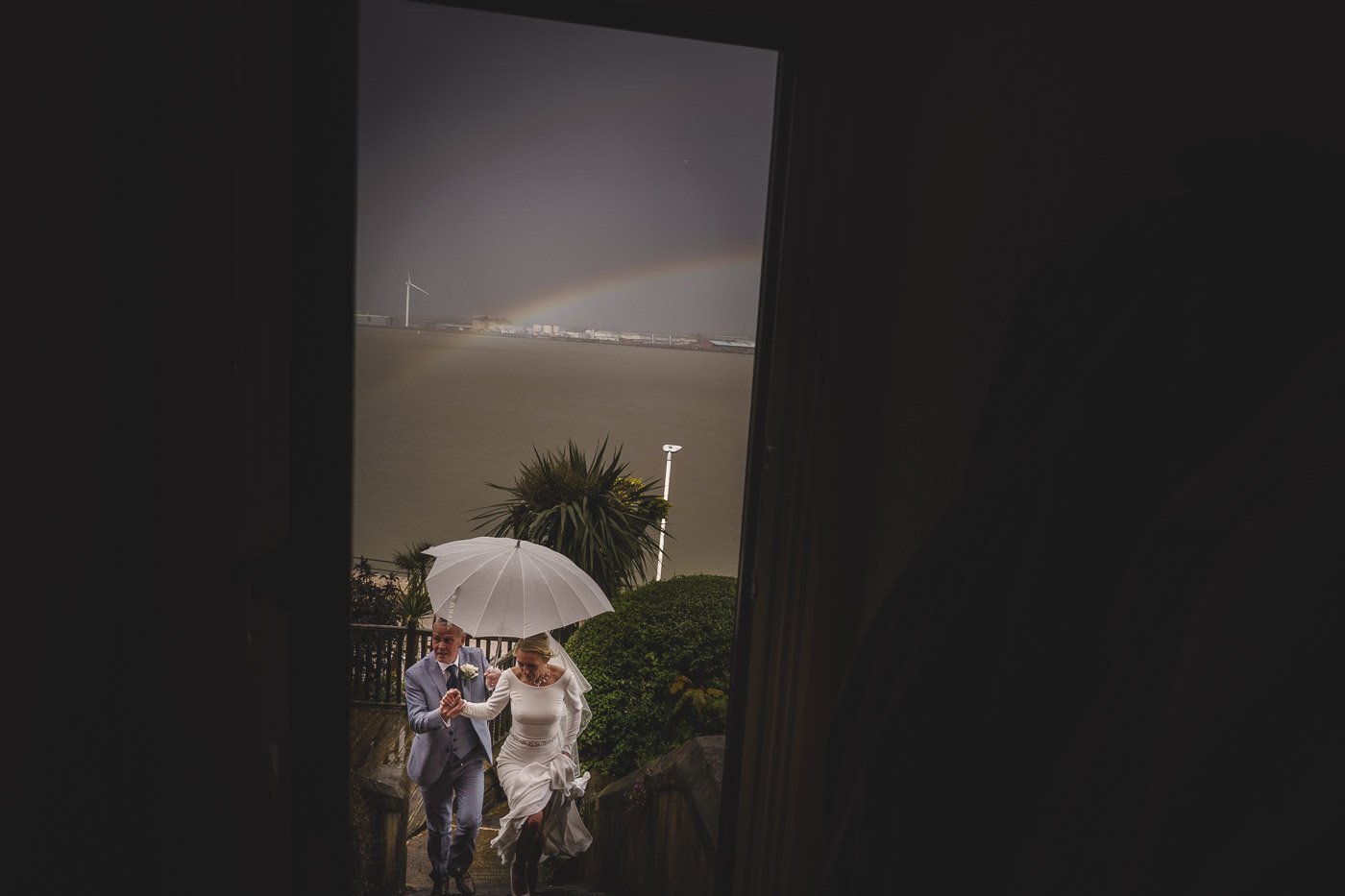 bride and groom returning home in a storm