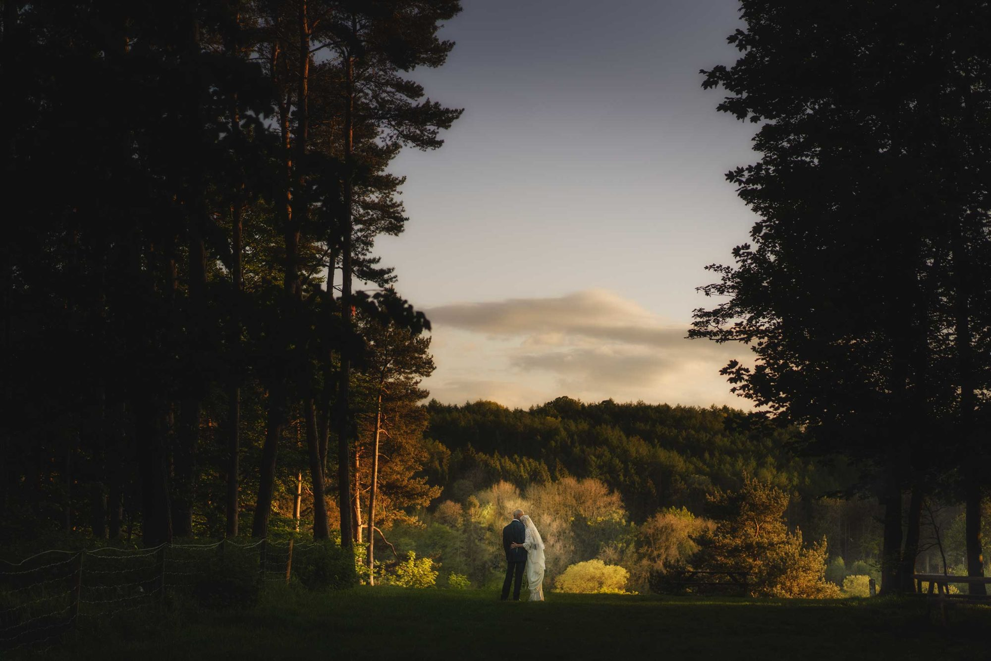 Bride and groom take in the view whilst the best Shropshire wedding photographer captures the scene