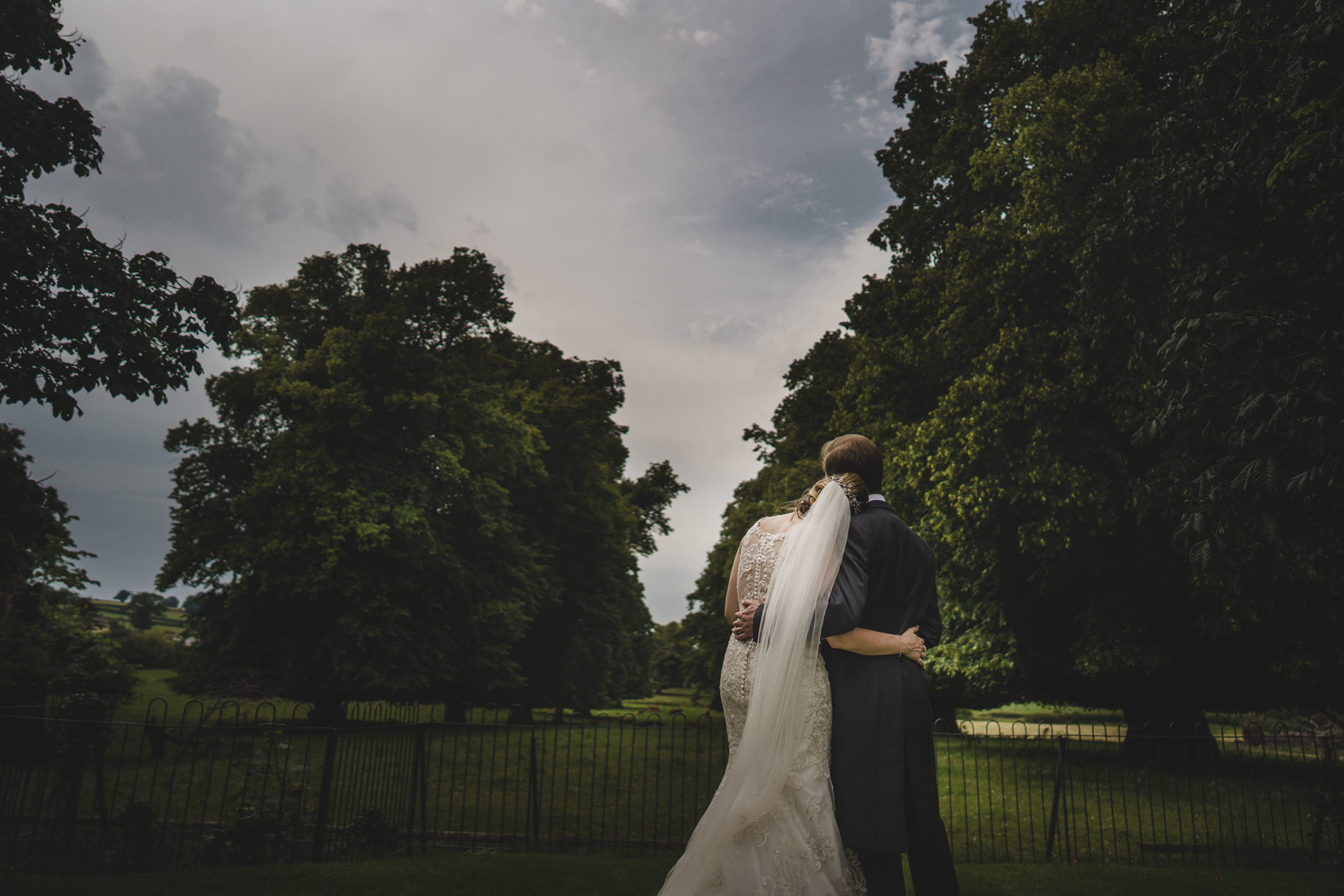 the bride and her groom share a quiet moment during their rowton castle wedding