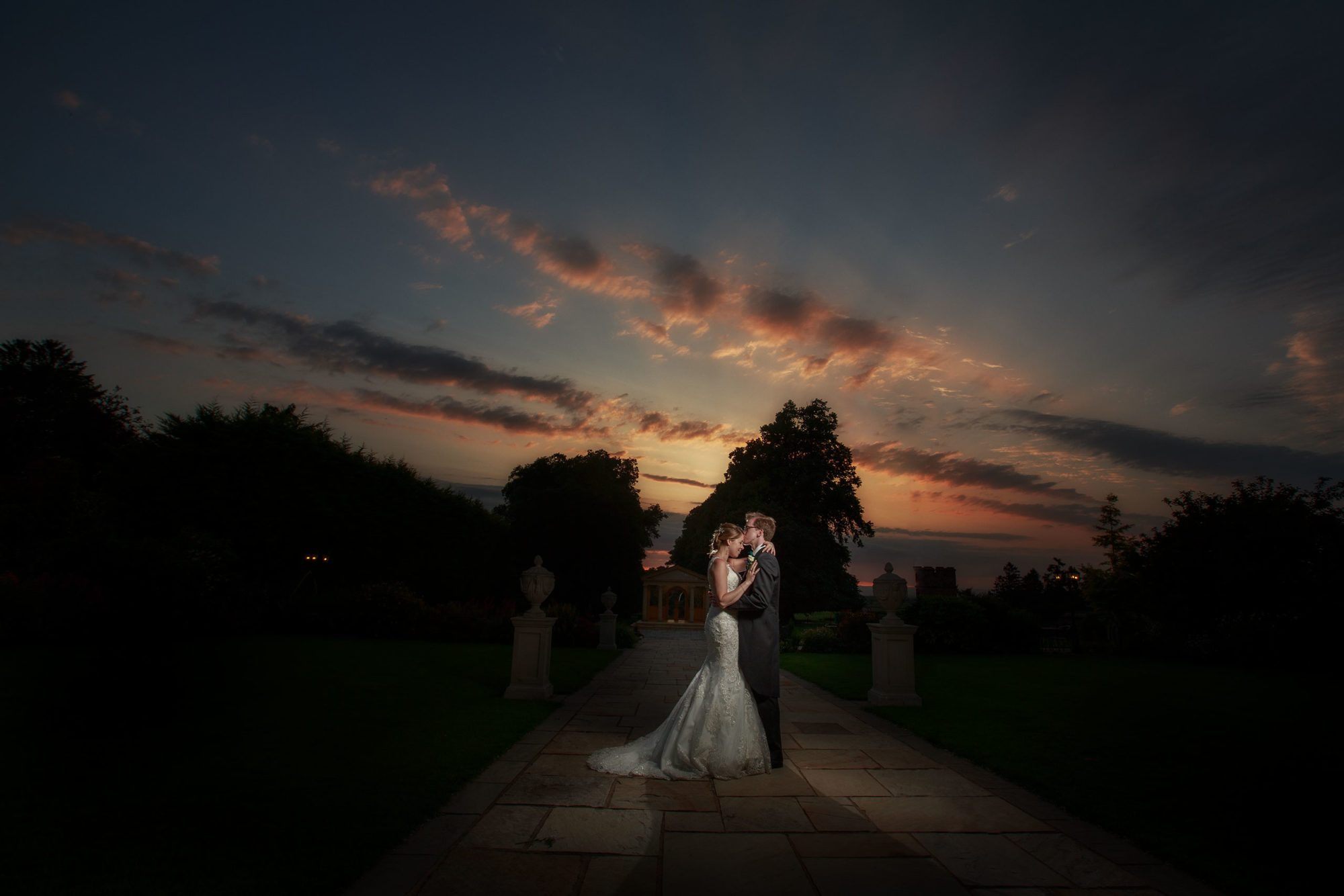 a stunning sunset provides the perfect end to this gorgeous rowton castle wedding
