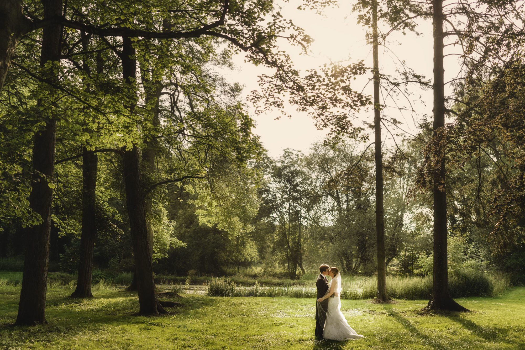 the bride and groom share an intimate moment in the grounds of Rowton Castle