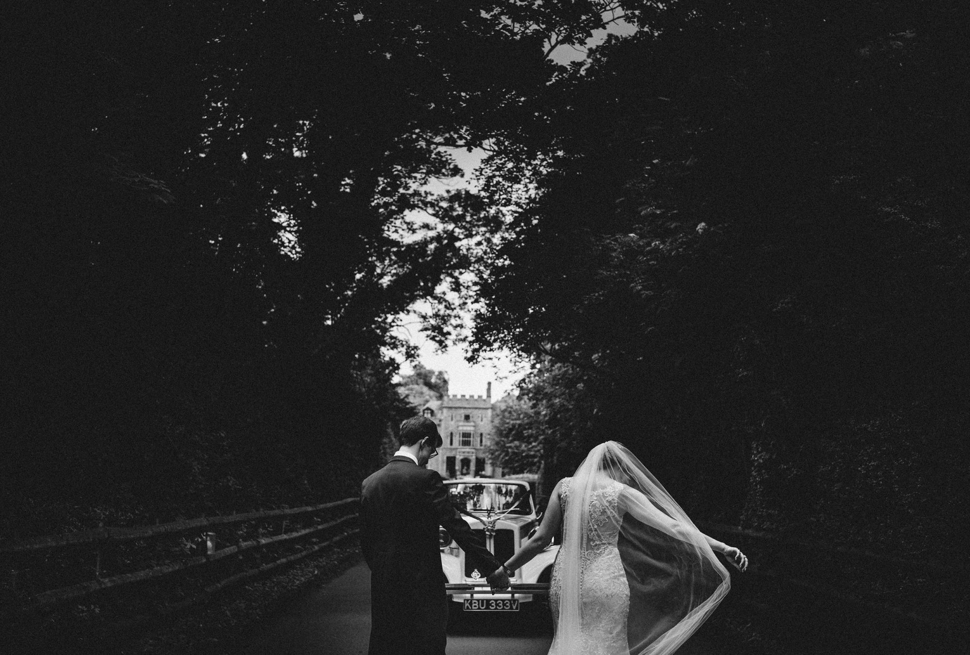 rowton castle provides the perfect backdrop as the bride and groom make their way to the wedding car