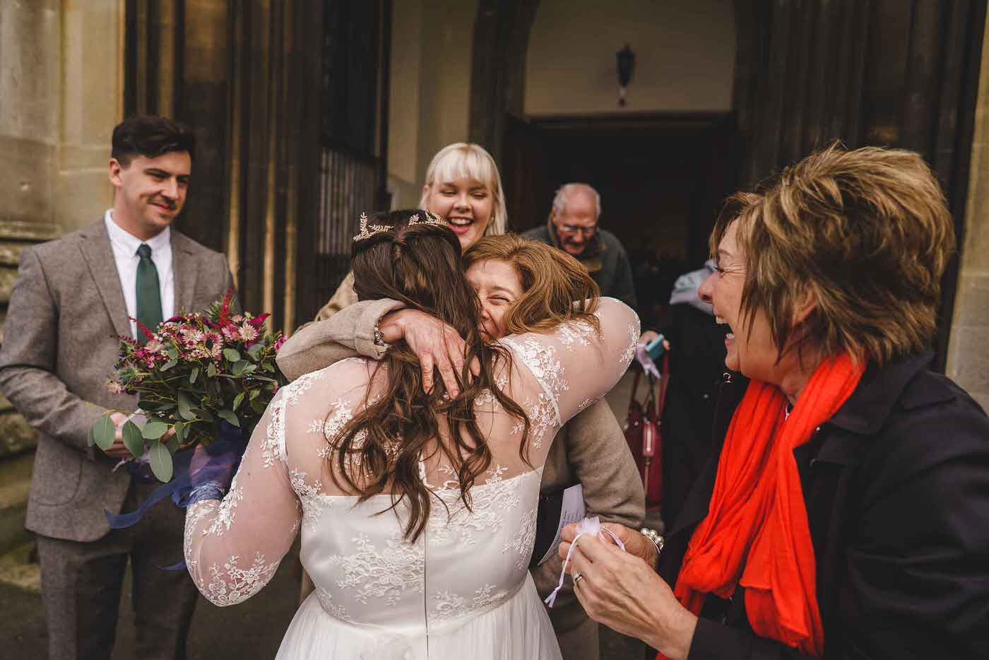 Hugs at a church wedding in Shropshire