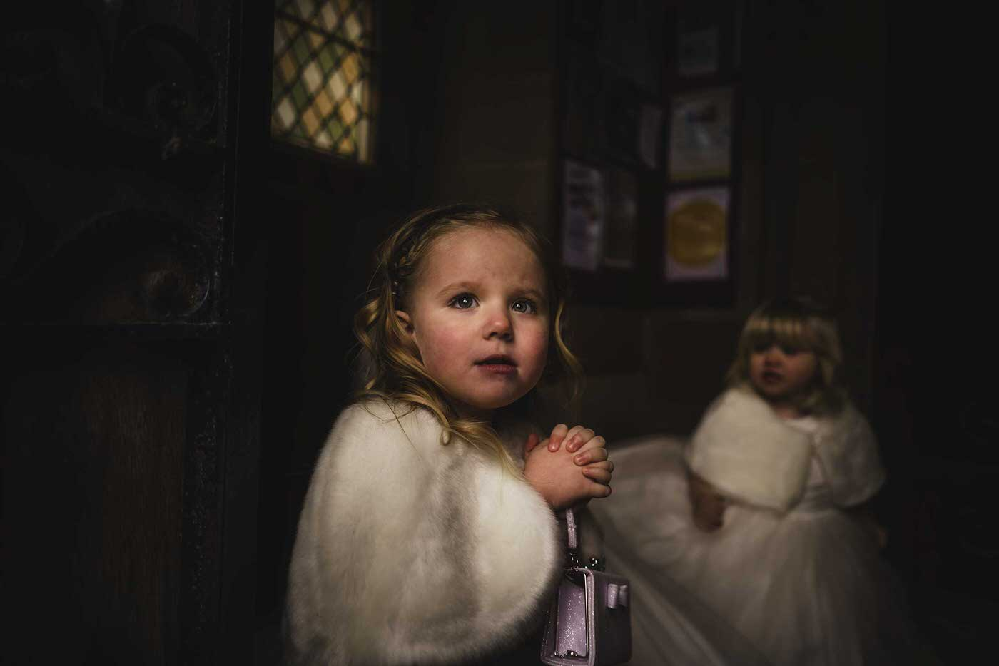 beautiful flower girl at Church, image taken by the best wedding photographer in Shropshire