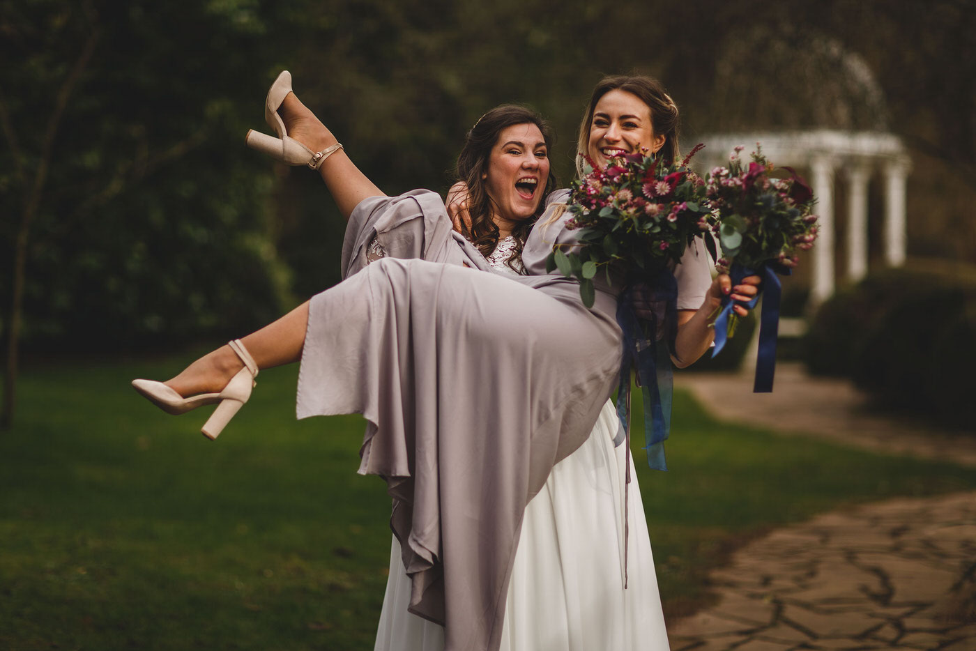 bride and bridesmaid at Mill Barns Wedding Venue, image taken by the best wedding photographer in Shropshire