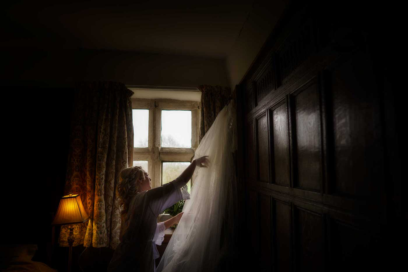bride getting ready at Soulton Hall image taken by the best wedding photographer in Shropshire