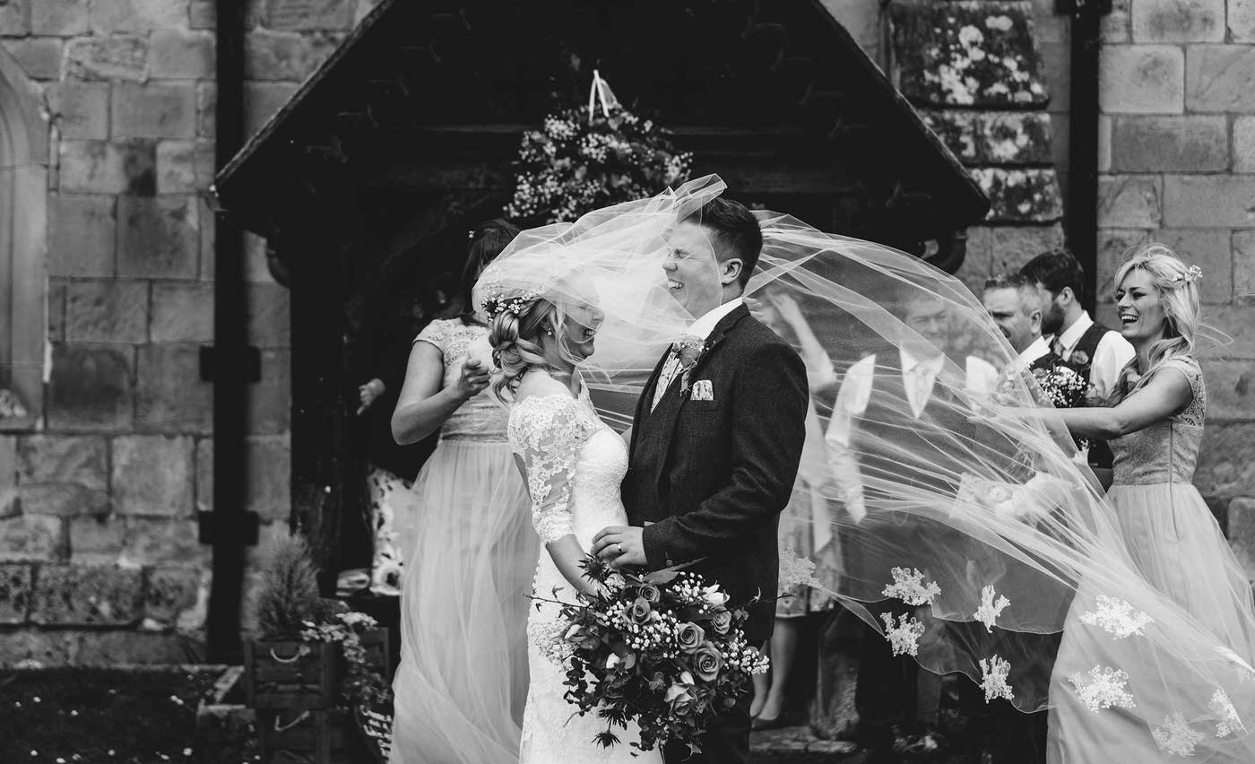 bride and groom at Shrewsbury Church, image taken by the best wedding photographer in Shropshire