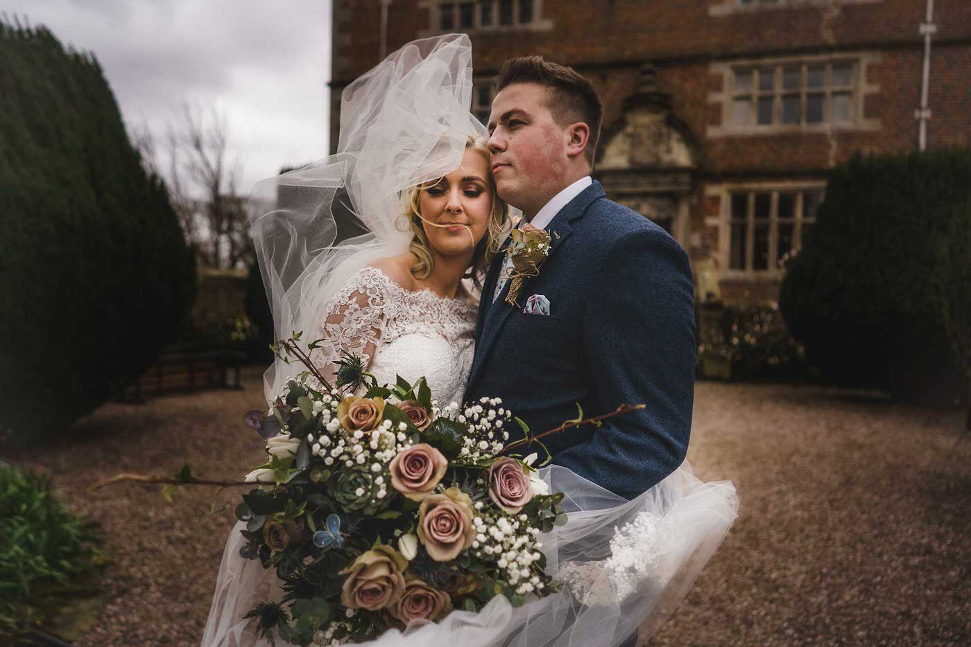 bride and groom at Soulton Hall, image taken by the best wedding photographer in Shropshire